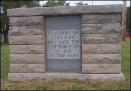 """The marker reads: """"In memory of John Lane who made the first steel plow in 1833 on this farm."""" Lane's invention made possible the settling of the prairie."""
